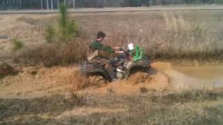 7. ARCTIC CAT 400 4X4 making easy work of a rutted hole