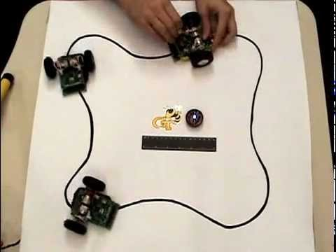 hizook - This wireless power system is similar to low-frequency RFID. There is a coil embedded under the table (like a RFID reader) that powers the robots (like tags)...
