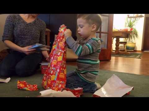 Boys 3rd birthday shredding of the presents