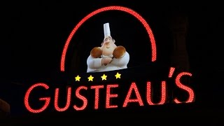 Gusteau's sign at the queue line for Ratatouille The Adventure