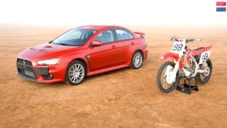 8. 2013 Mitsubishi Lancer Evolution GSR vs. 2010 Honda CRF450R - CAR and DRIVER