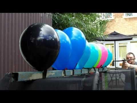 Pistol Crossbow vs Balloons in Slow Motion HD