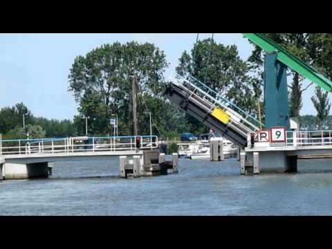 Sailing through canal Noord-Holland