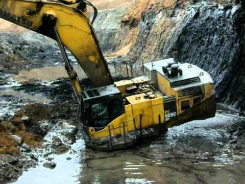 komatsu - A short video of a Komatsu PC1250 Excavator getting stuck in coal mine pit during my site visit to a coal mine.The skillful operator wriggled it out in a few...