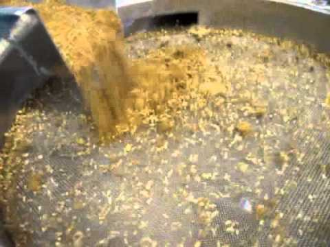 Vibraflo Through Sieve screening recycled animal protein for animal feed