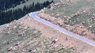 Sorry for the poor audio. This is part of Sebastian Loeb's record shattering run at the 2013 Pikes Peak International Hill Climb. The distance covered in this video is about 1.6 miles which means he averaged about 100 mph through this section. This was shot from the knoll above Devil's Playground about a mile away. The next section can be viewed here: http://www.youtube.com/watch?v=hDglHMoD9QcThe previous section can be viewed here: http://www.youtube.com/watch?v=1oaTY92EJnM