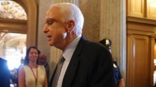 Sen. John McCain (R-Ariz.) battling brain cancer, returns to the senate floor to cast vote on health care bill debate.