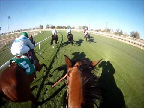 jockey - Phoenix, AZ - March 27th 2011 Turf Paradise Race 8 going 7 1/2 furlongs on the Turf. This POV HD helmet cam footage gives you a captivating and/or fascinatin...