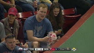 Red Sox fan nonchalantly catches a souvenir