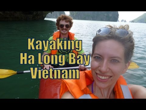 Kayaking along scenic Ha Long Bay, Vietnam