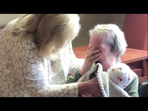 Two women give Alzheimer's patients baby dolls to comfort them