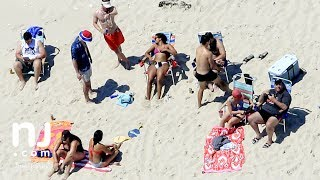 Chris Christie, family soak up sun on state beach he closed to public
