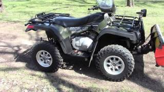 8. 2005 Arctic Cat 400 4x4 Auto with plow and winch