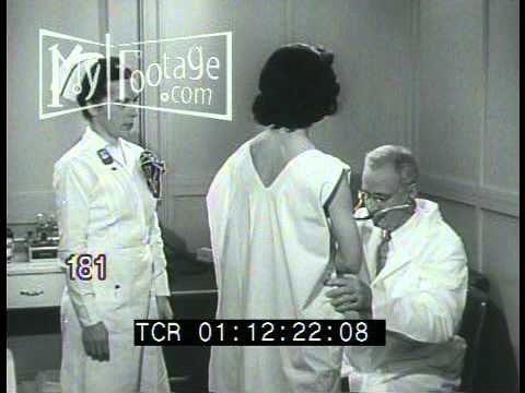 Stock Footage - 1940's DOCTOR'S OFFICE EXAMINATION OF PATIENTS,XRAY (видео)