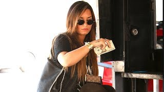 Wednesday, August 17th, 2011 - Demi Lovato was spotted outside the Nine Zero One Salon, in a long dress and studded bracelet ...