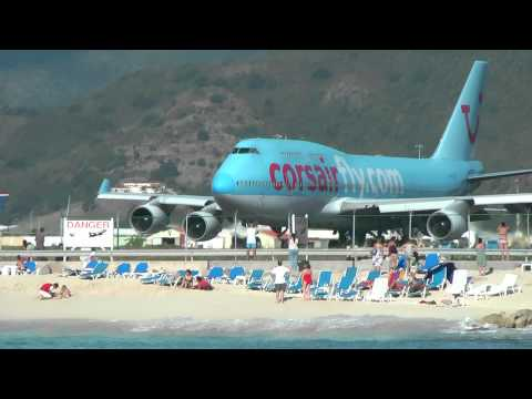 airports - Boeing 747 landing and taking off from St. Maarten in the Carribean, one of the World's scariest airports. Viewed from a catamaran 100 metres off the beach.
