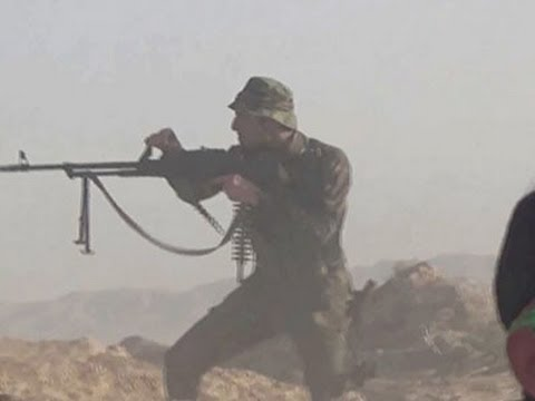 Battle - Video obtained by the Associated Press showed Iraqi government forces and Shiite militias firing towards militants from the Islamic State group on Monday. (Sept. 1) Subscribe for more Breaking...