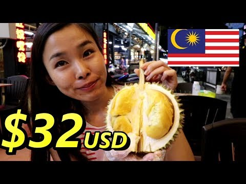 "Japanese girl is eating the most expensive durian ""Black Thorn"" in Penang"