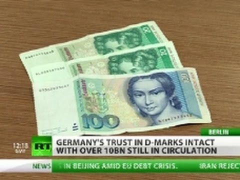 Euro (Currency) - While Germany is striving to make sure the Euro stays afloat, its old currency, the Deutschmark, is showing no signs of being discarded. RT's Peter Oliver ha...