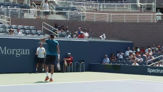 Marin Čilić and Feliciano López practicing at the Billie Jean King National Tennis Center.