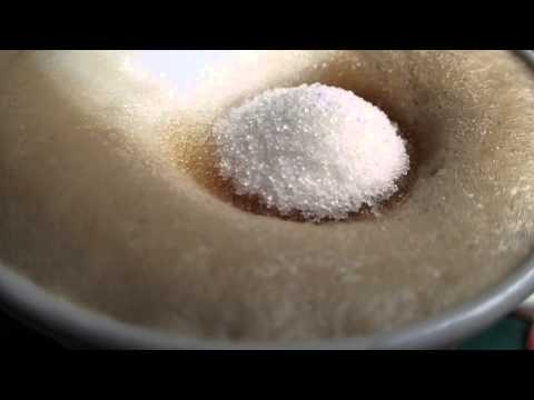 Adding sugar to coffee