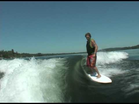 Jeff riding behind a Centurion on Inland Surfer Squirt board