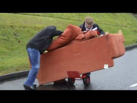 Two old Irish men try to move a sofa.