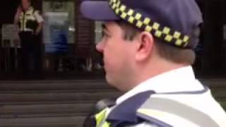 Protective service officers, acting on behalf of Victoria Police, try to have a member of the public remove their signs. The member of the public was petitioning for ...