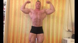 Russian giant bodybuilder Andrey Shokin home posing