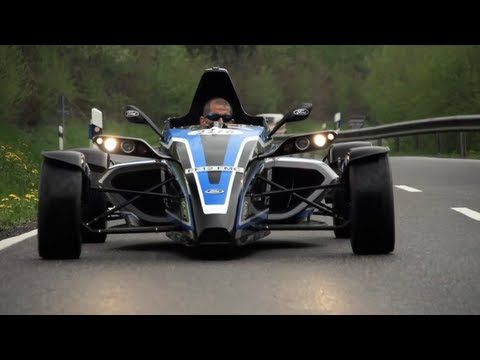 racer - You see, big car companies can have a sense of humour! Take a Formula Ford racer, add a tuned 1 litre 3cyl motor with over 200hp and you have a car which ace...