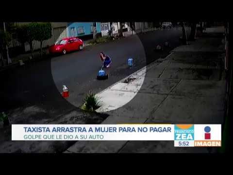 Taxista arrastra a mujer para no pagar golpe que le dio a su coche