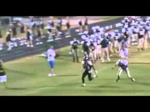 Watch Football Online.Football Player Jumps Over Defender.flv