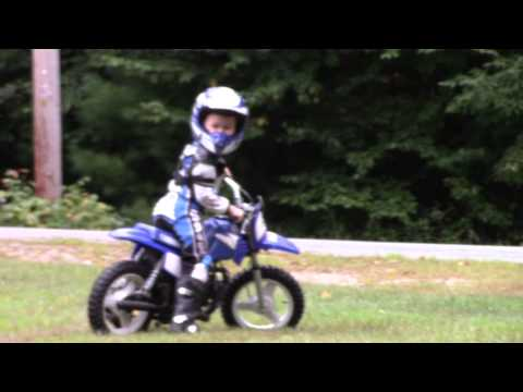Landon learning to ride his dirtbike without training wheels
