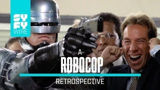 30 years ago (if you are reading this in 2017) Robocop exploded on to the screen, but how much do you really know about the Peter Weller/Paul Verhoeven film? Also, it's getting a statue in Detroit.►►Subscribe To SYFY Wire: http://po.st/SubscribeSYFYWireMore About Robocop: RoboCop is a 1987 American cyberpunk action film directed by Paul Verhoeven and written by Edward Neumeier and Michael Miner. The film stars Peter Weller, Nancy Allen, Dan O'Herlihy, Kurtwood Smith, Miguel Ferrer, and Ronny Cox. Set in a crime-ridden Detroit, Michigan, in the near future, RoboCop centers on police officer Alex Murphy (Weller) who is murdered by a gang of criminals and subsequently revived by the megacorporation Omni Consumer Products (OCP) as a superhuman cyborg law enforcer known as RoboCop.SYFY WIRE is a fan-first genre news and editorial destination dedicated to covering science fiction and nerd culture across TV, Film, Books, Comics, space and technology with up-to-the-minute news, in-depth analysis and content that drives conversation and debate.Visit SYFYWIRE.com: po.st/SYFYWIREFind SYFYWIRE on Facebook: po.st/LikeSYFYWIREFollow SYFYWIRE on Twitter: po.st/FollowSYFYWIRERobocop: Everything You Didn't Know  SYFY WIREhttps://www.youtube.com/channel/UC985XM8r_uh-_znGrj8HG9w