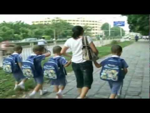 Raw Video: Chinese Quads Sport Unusual Hair Cuts