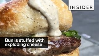 This burger bun is stuffed with exploding cheese