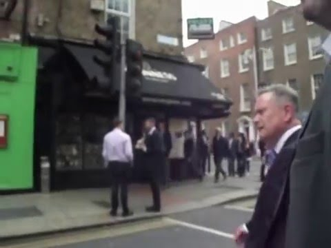Minister Howlin Tries to grab camera from a member of Dublin Says NO