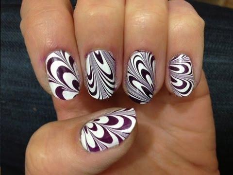 קישוטי ציפורניים - לק במים water marble nail art purple & white קישוטי ציפורניים בטכניקת לק במים השתמשתי בלקים בצבעים סגול כהה ולבן.