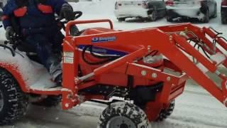 2. Simplicity Legacy 4x4 Diesel garden tractor at work