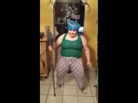 Lady dancing with a broom to a Puerto Rican song
