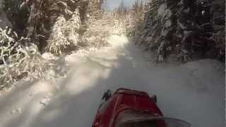 3. snowmobile polaris 500 indy wide track in deep snow