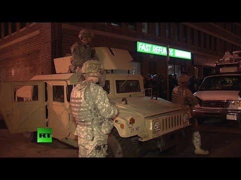 Soldiers, riot police patrol Baltimore amid mandatory curfew
