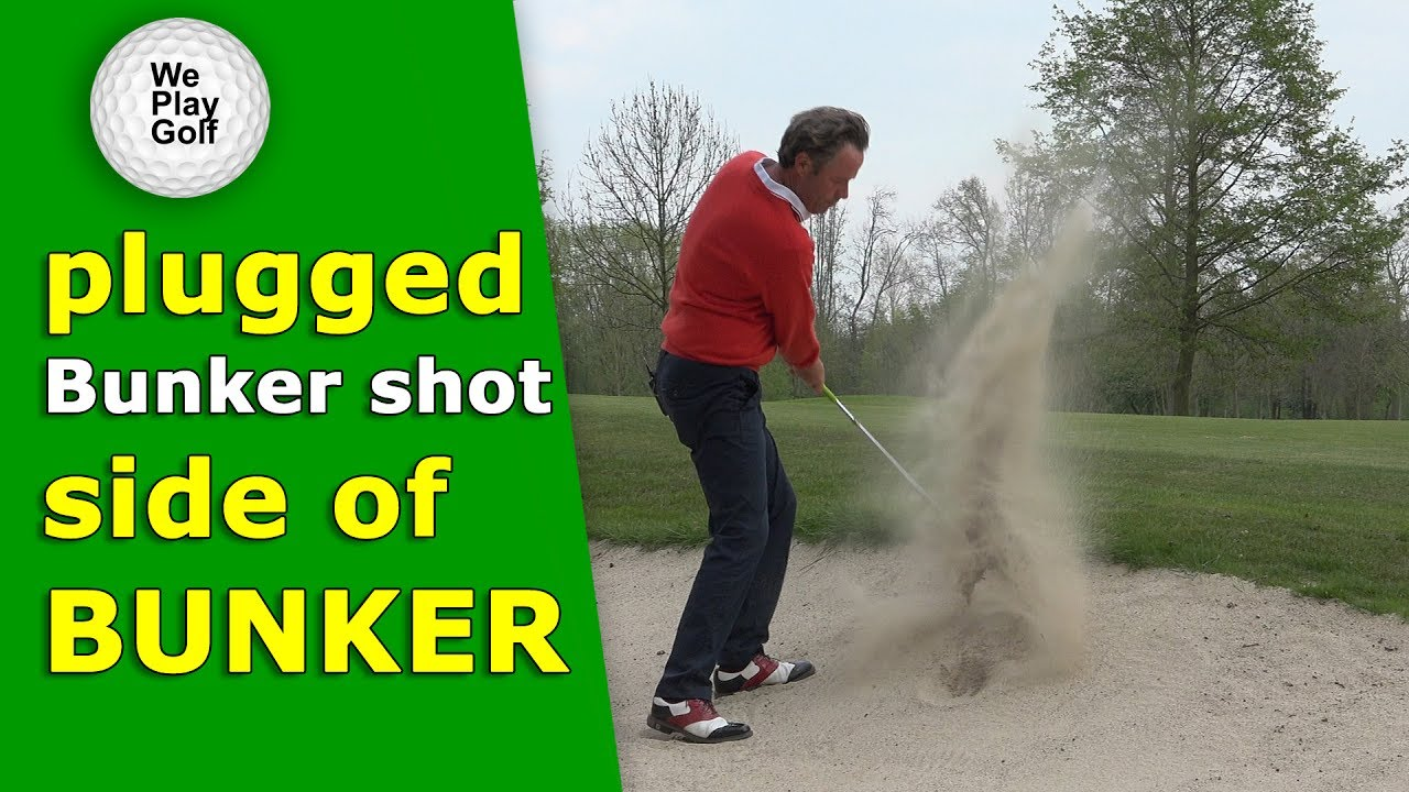 How to play a plugged ball in the side of the bunker?