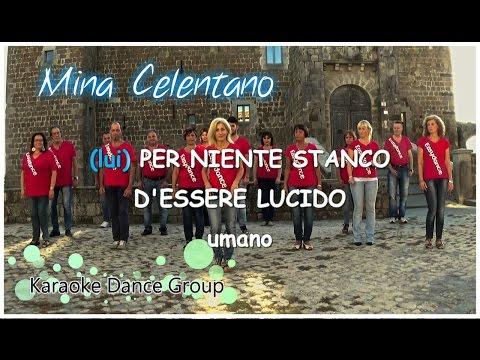 , title : 'Mina-Celentano - A UN PASSO DA TE    Dance - Ballo di Gruppo Mix -Vers. Karaoke   Midley Totem Mario'