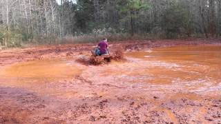 8. King quad 400 on 27 mud lites