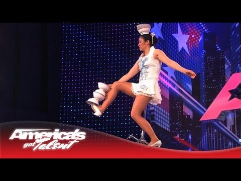 agt - Red Panda shows off her balance with style. Count the bowls she catches on her head while riding a unicycle in heels. Subscribe Now for More AGT: http://full...