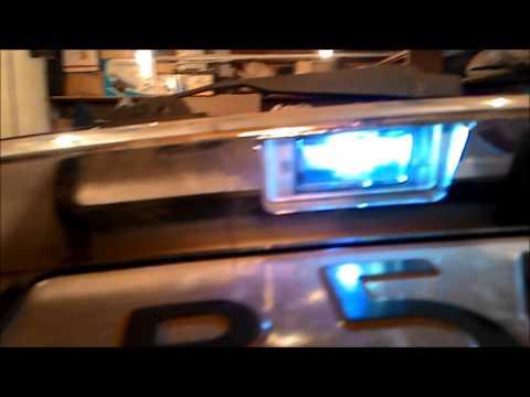 Как заменить на приоре лампочки подсветки номера фото