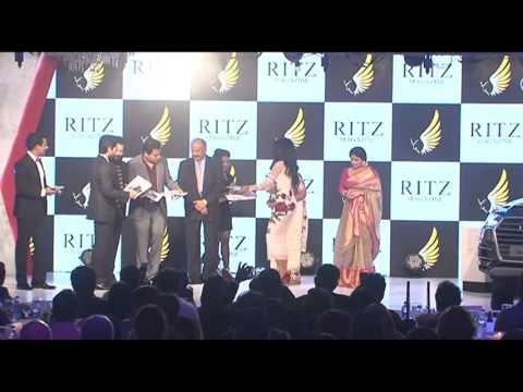 Unveiling the cover of the December 2015 issue of Ritz