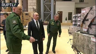 RAW: Putin checks out weaponry seized from Syrian militants