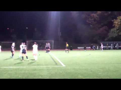 Alec Spivack scores the game-winner for women's soccer against Lesley University, Oct. 18